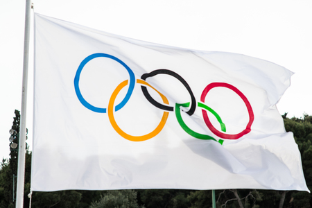 olympic ring: ATHENS, GREECE - APRIL 27, 2016: An Olympic flag flutters in the wind.