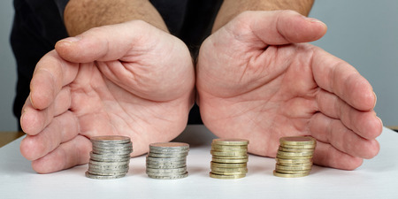 protect money: Hands protect Euro coins money.