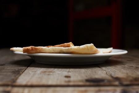 armenian: Armenian flatbread lavas on wooden table. Stock Photo