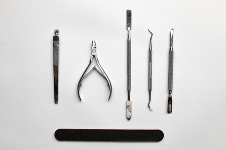 manicure set: Tools of a manicure set on a white background