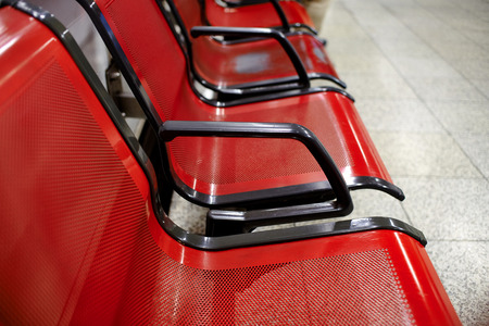 seating area: Red chairs in a metro station.