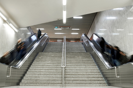 Escalator stairs with crowd in the Terminal.