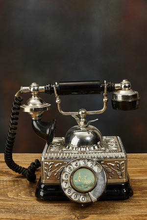 Vintage telephone on wooden table.