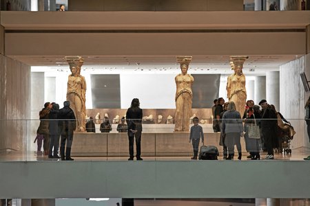 ATHENS, GREECE - DECEMBER 30, 2016: Interior view of the Acropolis museum in Athens with crowd.
