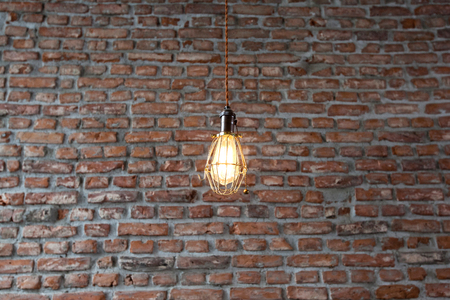 Light fixtures on a wall with bricks background.