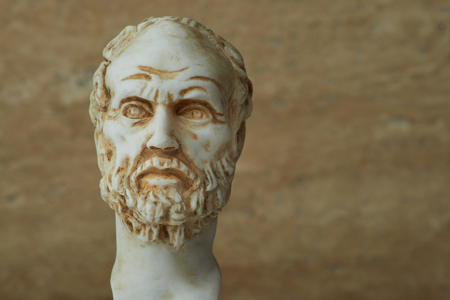 philosophic: Statue of Demokritus,ancient greek philosopher. Stock Photo
