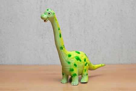 Brachiosaurus dinosaurs toy on wooden table. Stock Photo