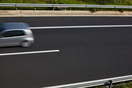 Car in motion blur on a highway.