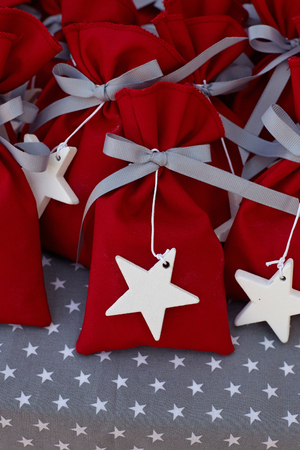 Red fabric pouches with white stars. Stock fotó