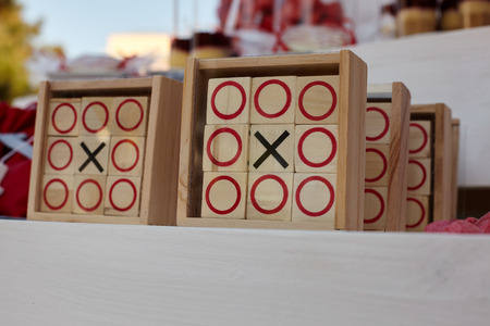 Tic-tac-toe game on white wooden background. Stock fotó