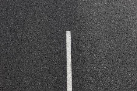 Asphalt road with white mark line.