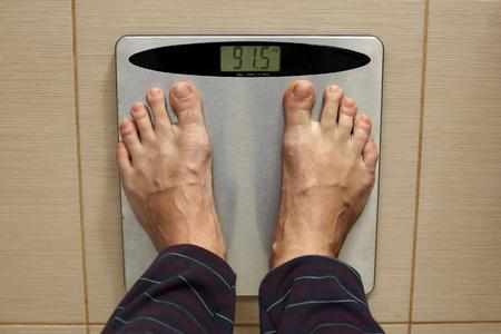 Mans leg on a scale. Stock fotó