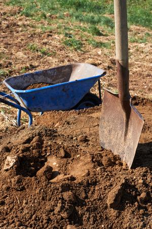 Shovel on soil and trolley.Gardening.