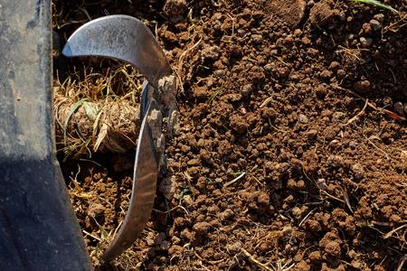 Motor cultivator on soil.