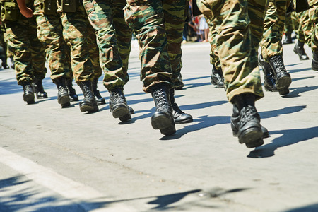 Soldiers dressed in camouflage uniform in an army parade. Stock fotó