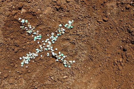 Ex symbol written from chemical fertilizer on soil. Stock fotó