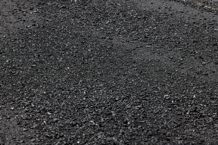 Fresh asphalt background.Construction road.