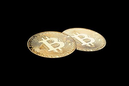 Golden Bitcoins on black background.Virtual money. Stock fotó