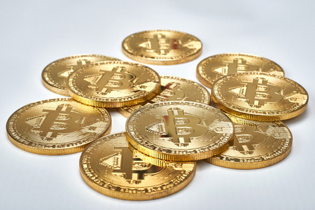 Golden Bitcoins on white background.Virtual money. Stock fotó