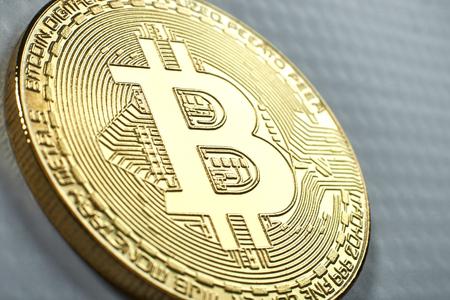 Golden Bitcoin on grey background.Virtual money.
