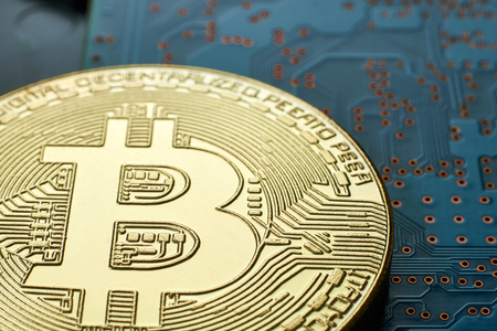 Golden Bitcoin on digital pc hard disk.Virtual money.