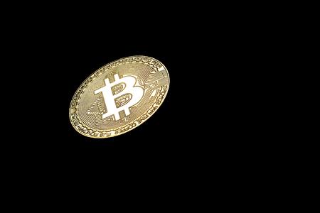 Golden Bitcoin on black background.Virtual money.