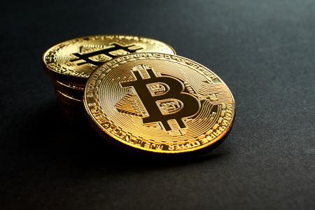 Golden Bitcoins on black background.Virtual money. Stock fotó - 106198740