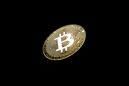 Golden Bitcoin on black background.Virtual money. Stock fotó - 106198741