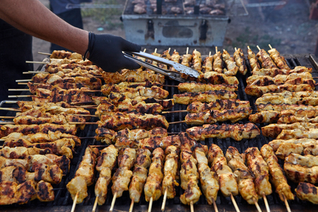 Greek souvlaki.Tasty traditional food from meat of chicken cooking on big barbecue. Stock fotó - 121627050