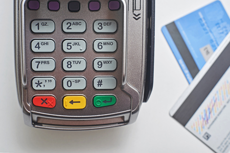 Payment terminal and credit card as background. Standard-Bild - 121627031