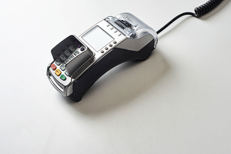Credit card reader on white table background. Standard-Bild - 121627066