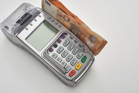Credit card reader with money.Electronic money and cash. Standard-Bild - 121627078