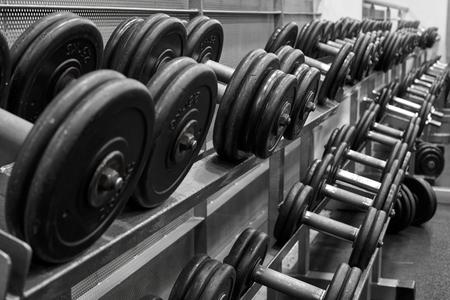 Metal dumbbells on rack in sport fitness center.Gym equipment. Stock fotó - 121627169