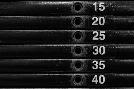 Close-up of stack metal weights in gym equipment. Standard-Bild - 121627170