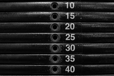 Close-up of stack metal weights in gym equipment. Standard-Bild - 121627177