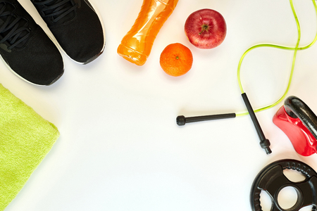 Fitness concept.Fruits, gym equipment and sport clothing on white background.Healthy lifeslile. Stock fotó - 121627109