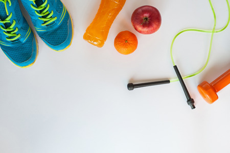 Fitness concept.Fruits, gym equipment and sport clothing on white background.Healthy lifeslile. Stock fotó - 121627114