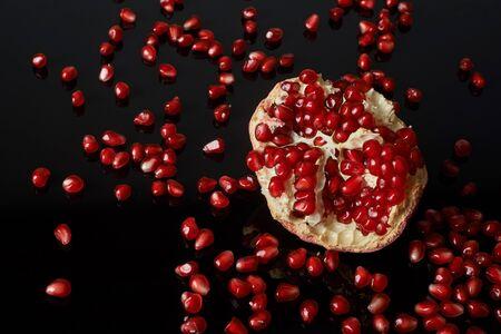 pomegranate fruit on black background. Reklamní fotografie