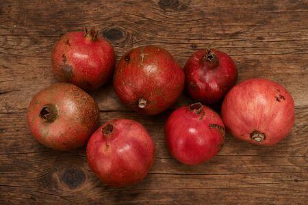 pomegranate fruits on wooden table. Reklamní fotografie