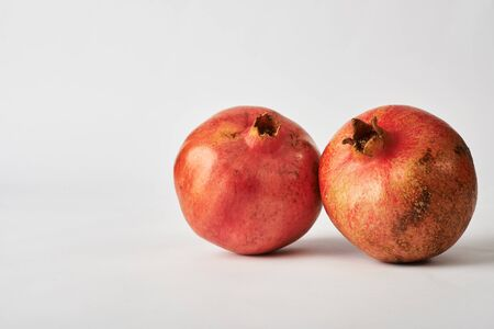pomegranate fruits on white background.