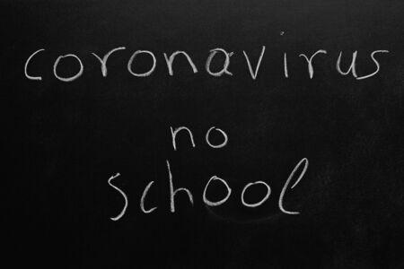 the word coronavirus no school written on a blackboard.