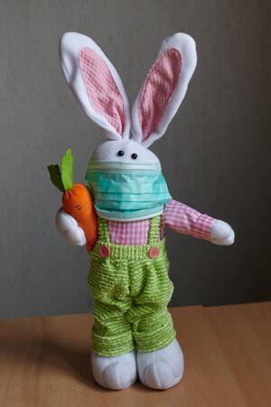 Easter rabbit wearing a medical mask. Coronavirus.