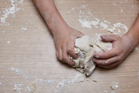 Kid you are playing and making dough.