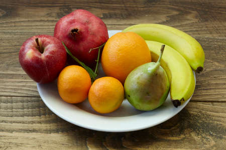 fruits on wooden table. healthy diet. Standard-Bild - 161618597