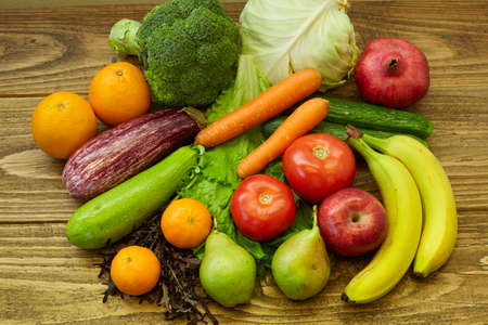 vegetables and fruits on wooden table. healthy diet.