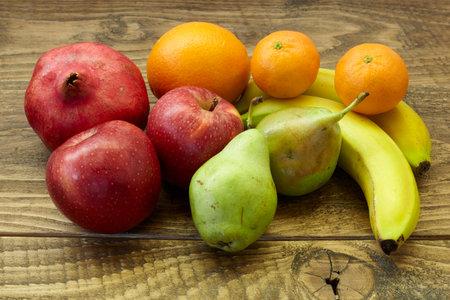 fruits on wooden table. healthy diet. Standard-Bild