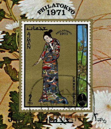 Ajman circa 1970. A stamp printed in Ajman shows image of the japanese geisha.