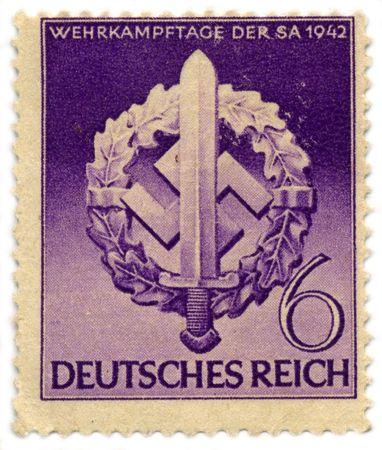 reich: DEUTSCHES REICH - CIRCA 1942: A stamp printed in DEUTSCHES REICH shows image of the sword, wreath and swastika, circa 1942. Editorial