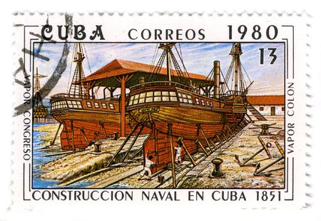 loopholes: CUBA - CIRCA 1980: A stamp printed in Cuba shows image of the construction of a wooden sailboat, circa 1980.