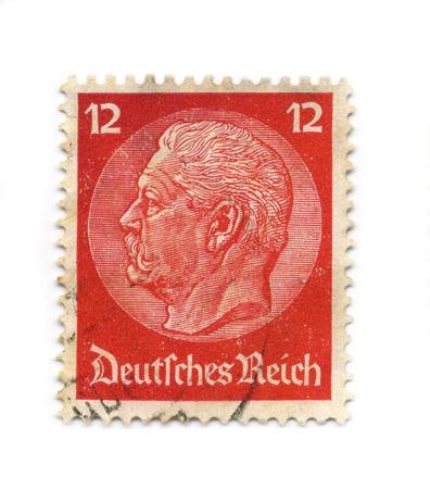 hindenburg: GERMANY - CIRCA 1934: An GERMANY Used Red Postage Stamp showing Portrait of Paul Ludwig Hans Anton von Beneckendorff und von Hindenburg, circa 1934. Editorial